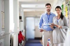 Teachers in the Corridor Stock Image