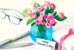 Teachers day greeting card. Teacher`s day holiday design still life image.Flowers bouquet on table stock photo