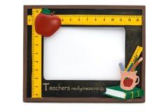 Teachers Frame 2. A teachers photo frame with apple, globe,pencils and books Stock Image