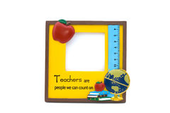 Teachers Frame. A yellow teachers photo frame with apple, globe and books Royalty Free Stock Image