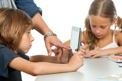Teachers hand pointing on kids tablet. Stock Photo