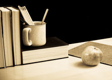 Teachers Love for Education. Teachers Desk With Supplies And Apple Royalty Free Stock Image