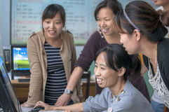 Teachers. Multimedia has become Chinas rural schools the conventional teaching methods. This is the teachers in the discussion PPT courseware. Baixiang County Royalty Free Stock Image