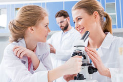Teachers scientists and student chemists in white coats working together Royalty Free Stock Photos