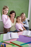 Teachers and students in classroom. Back to school - teachers and elementary students in classroom, 8-9 years old Royalty Free Stock Image