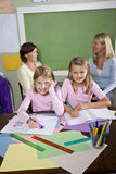 Teachers and students in classroom. Back to school - teachers and elementary students in classroom, 8-9 years old Royalty Free Stock Photo