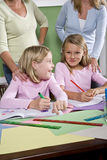 Teachers and students in classroom. Back to school - teachers and elementary students in classroom, 8-9 years old Stock Photos