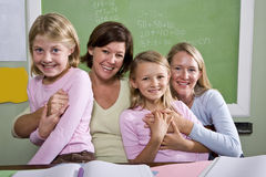 Teachers and students in classroom Stock Image