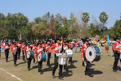 Marching band and students are walking the parade. royalty free stock photo