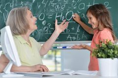 Teachers working with pupil Stock Photos