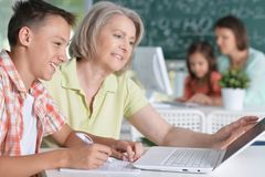 Teachers working with pupils Royalty Free Stock Photo