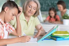 Teachers working with pupils. In computer class stock images