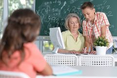 Teachers working with pupils Stock Photo