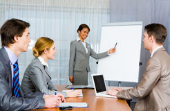 Teaching. Photo of confident employer teaching business people how to manage organization stock images