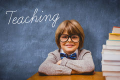 Teaching against blue chalkboard. The word teaching and pupil with many books against blue chalkboard stock image
