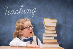Teaching against blue chalkboard Royalty Free Stock Photos