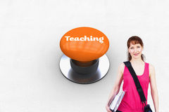 Teaching against orange push button. The word teaching and woman holding her school notebooks against orange push button Royalty Free Stock Photos