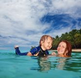 Teaching baby to swim Stock Images