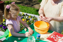 Teaching children creative modeling from dough Stock Photo