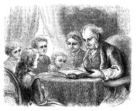 Teaching children to read. An engraved illustration image of  a father and mother reading a book or Bible to teach their children how to read from a Victorian Royalty Free Stock Photo