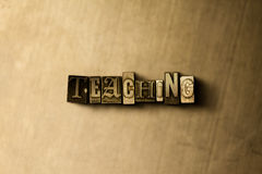 TEACHING - close-up of grungy vintage typeset word on metal backdrop. Royalty free stock - 3D rendered stock image.  Can be used for online banner ads and Stock Photos