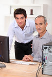 Teaching computing to senior Stock Photos