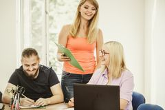 Students and teacher tutor in classroom Royalty Free Stock Image