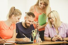 Students and teacher tutor in classroom Stock Image