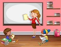 Teaching. Female teacher teaching in the classroom Royalty Free Stock Photos