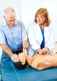 Teaching First Aid CPR royalty free stock photo
