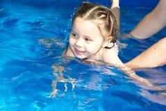 Teaching girl swim Royalty Free Stock Photography