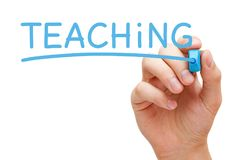 Teaching Handwritten With Blue Marker Royalty Free Stock Photography