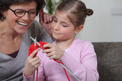 Teaching her daughter how to knit. Stock Photography