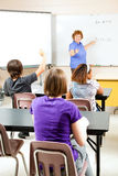 Teaching High School Algebra. Happy teacher instructing a high school class on algebra royalty free stock images