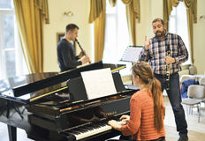 Teaching how to play clarinet and piano. Musician teaching how to play musical instruments at the academy of music, lithuania Stock Photos