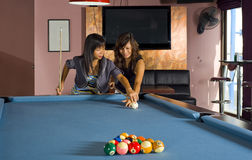 Teaching how to play pool Royalty Free Stock Photo