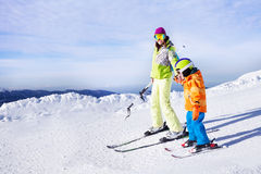 Teaching little boy to ski going holding hand Royalty Free Stock Photos
