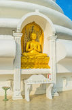 The Teaching Lord Buddha. The statue of Lord Buddha, teaching about the cosmic order, in niche of Japanese Peace Pagoda on Rumassala Mount, Unawatuna, Sri Lanka stock photo