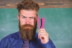 Teaching memorization techniques. Back to school and studying. Teacher bearded man with pink stapler chalkboard. Background. Pin it on mind. Hipster teacher royalty free stock photo