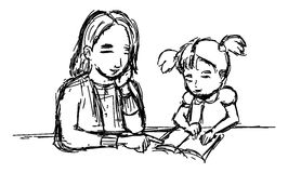 Teaching. A mother who was teaching his daughter to read the letter alphabet Stock Image