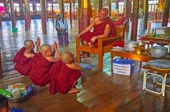 Teaching of novice monks, Nga Phe Chaung Monastery, Inle Lake, M. INLE LAKE, MYANMAR - FEBRUARY 18, 2018: The bhikkhu monk talks to the boys - samaneras novice Stock Photos