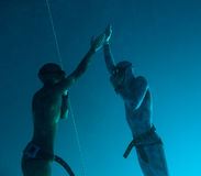 Teaching the pressure equalization technique. Two freedivers are teaching the pressure equalization technique during deep dive in Blue Hole, Red Sea, Egypt royalty free stock images