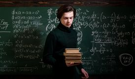 Teaching private classes is one of the best options for teacher now. Modern teacher hipster writing on big blackboard. With math formula. Trying student is the stock photography