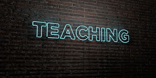 TEACHING -Realistic Neon Sign on Brick Wall background - 3D rendered royalty free stock image. Can be used for online banner ads and direct mailers Royalty Free Stock Image