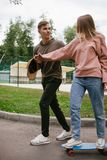 Teaching skateboarding active lifestyle trust. Skateboarding teaching lessons. Active lifestyle. Teenage relationships leisure and hobby. Trust concept Stock Photo