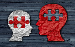 Teaching A Student. Education concept as an adult teacher educating a young child as crumpled paper shaped as a head and jigsaw puzzle piece as a learning Stock Images