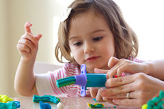 Teaching to use play dough Royalty Free Stock Image