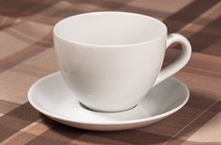 Teacup. Closeup of teacup on table-cloth royalty free stock photo