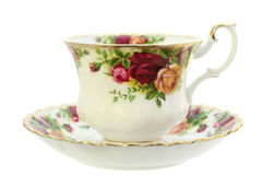 Teacup. A classic gold-rimmed floral china teacup and saucer.  Isolated on white Royalty Free Stock Images