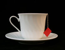 Teacup. White teacup with teabag string hanging out royalty free stock photos